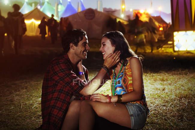 Affectionate couple outside music festival — Stock Photo