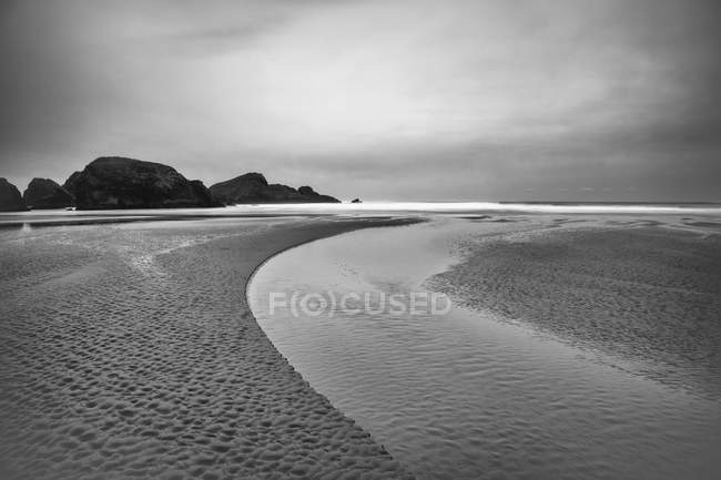 Creek connecting to ocean, balck and white — Stock Photo