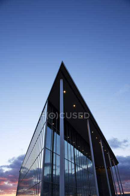 Modern building and sunset sky — Stock Photo