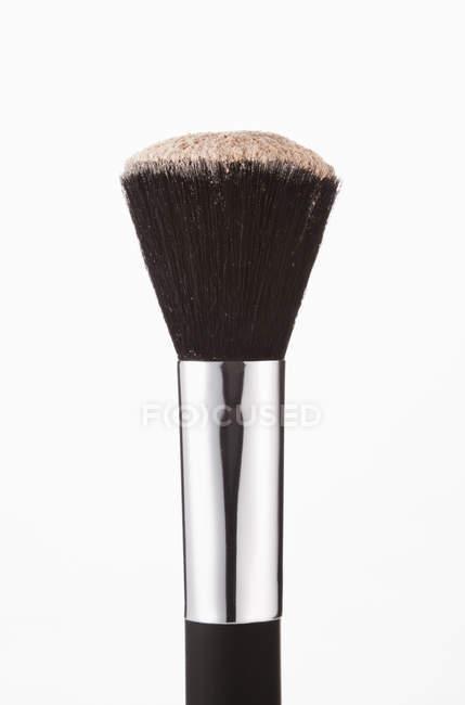 Close up of blush powder on makeup brush — Stock Photo
