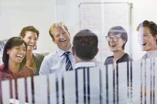 Business people laughing in meeting at modern office — Stock Photo