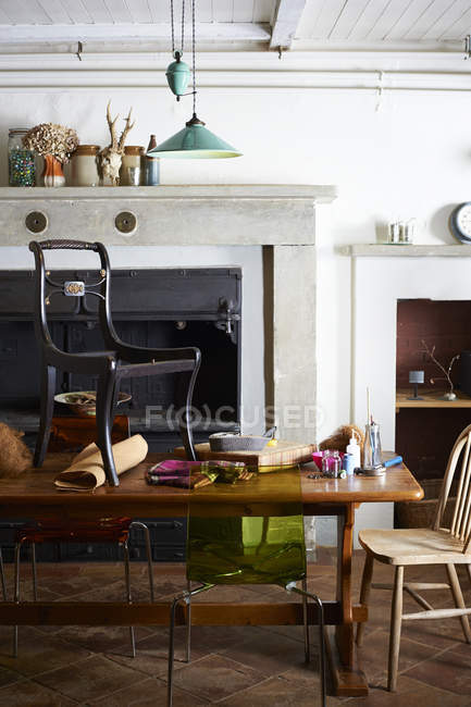 Chair with upholstery supplies on table — Stock Photo