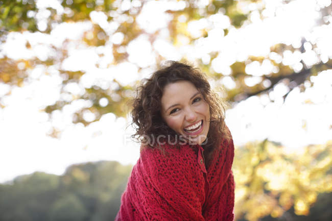 Smiling woman standing outdoors — Stock Photo