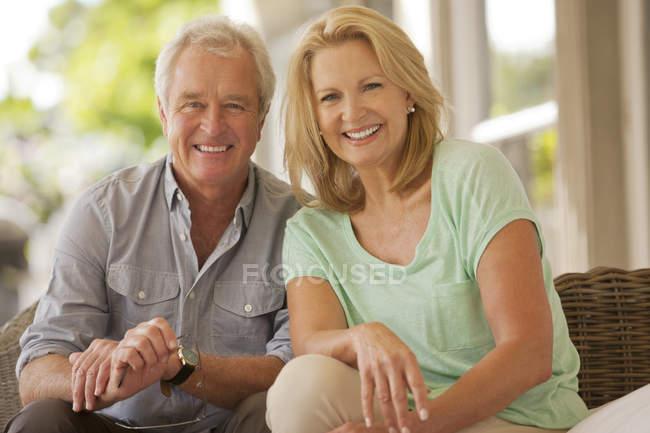 Portrait of smiling couple on patio — Stock Photo