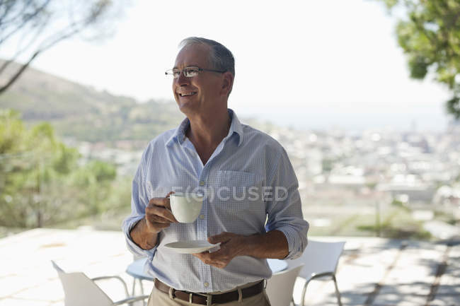 Man drinking cup of coffee outdoors — Stock Photo