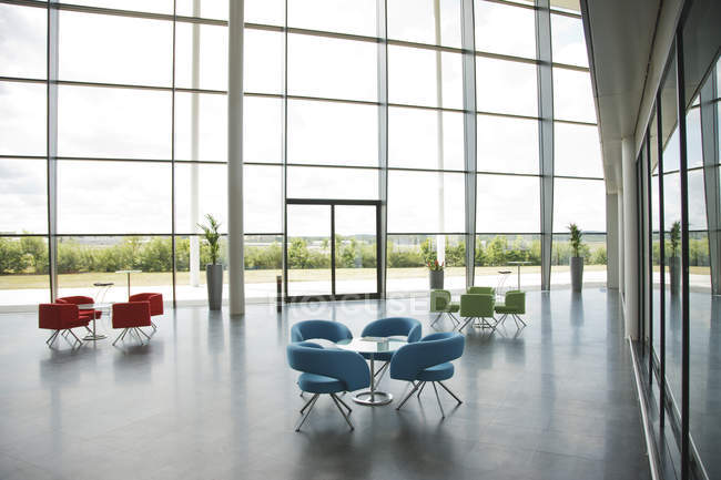 Chairs and tables in office lobby area — Stock Photo