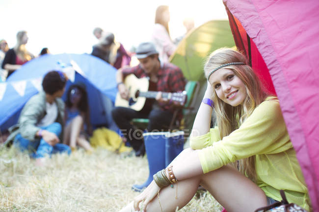 Portrait of smiling woman at tent at music festival — Stock Photo