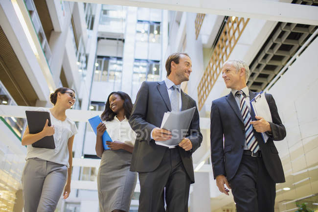 Business people walking together in office building — Stock Photo