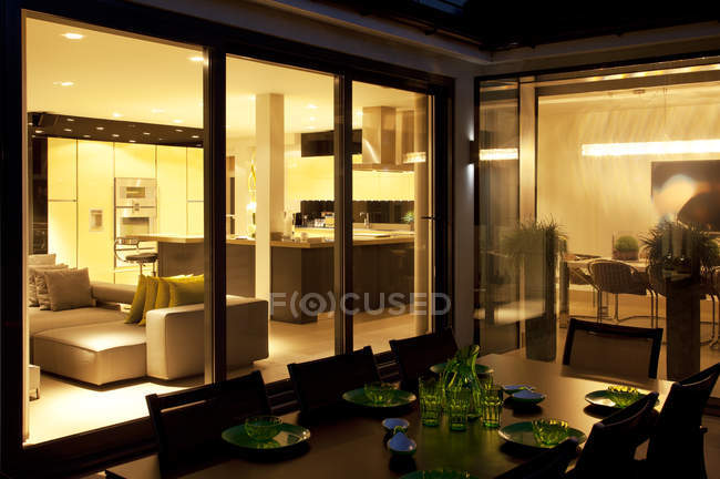 Outdoor table and living room of modern home — Stock Photo