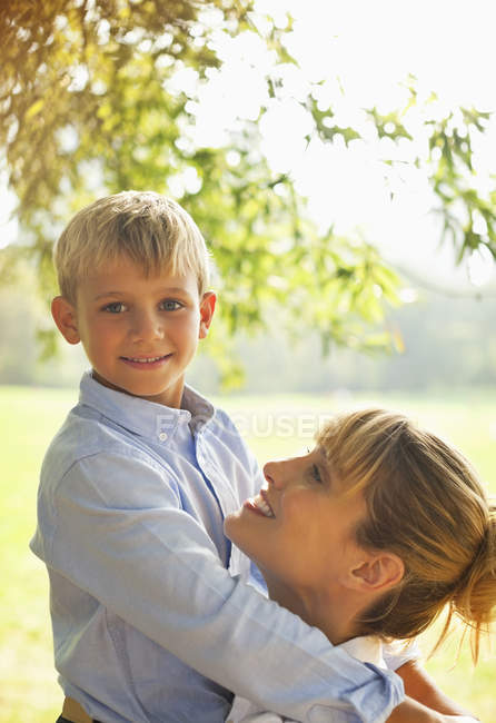 Mother and son hugging in park — Stock Photo