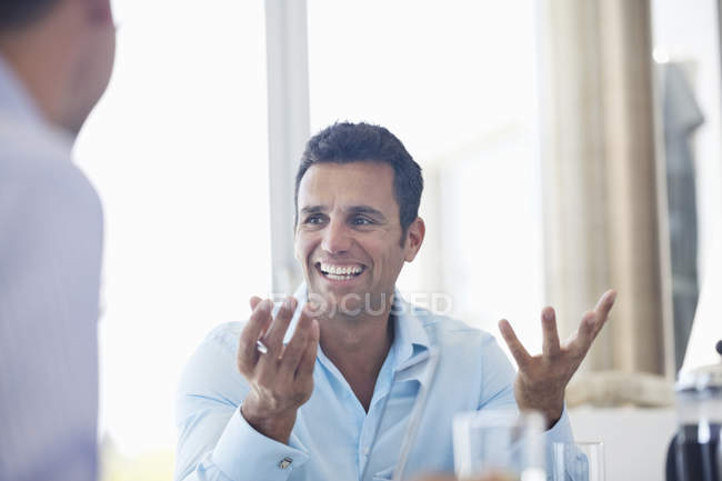 Businessman talking in meeting at modern office — Stock Photo