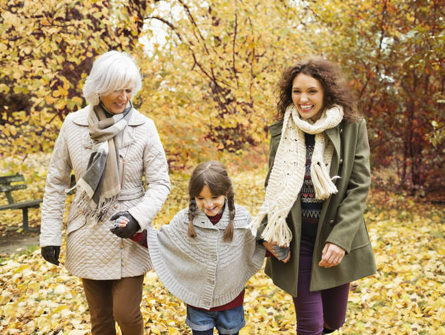 Three generations of women walking in park — Stock Photo