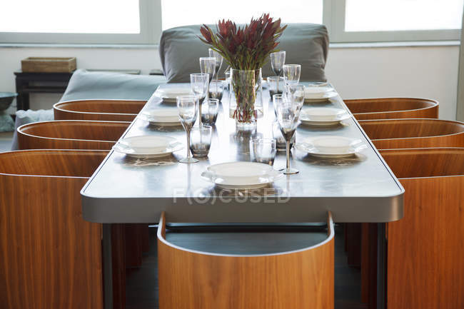 Place settings on table in luxury dining room — Stock Photo