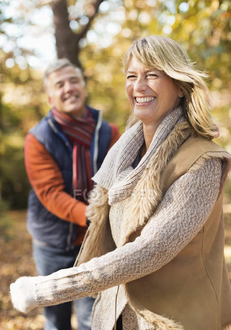 Older couple walking together in park — Stock Photo