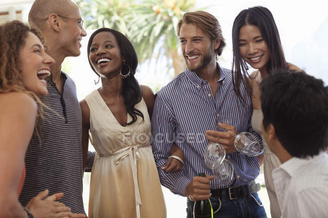 Young attractive Friends talking at party — Stock Photo