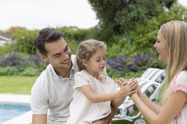 Happy caucasian family playing together in backyard — Stock Photo