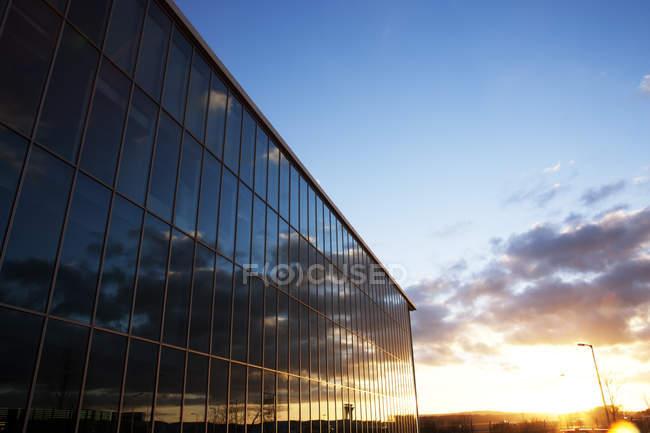 Sunrise sky reflected in modern building windows — Stock Photo