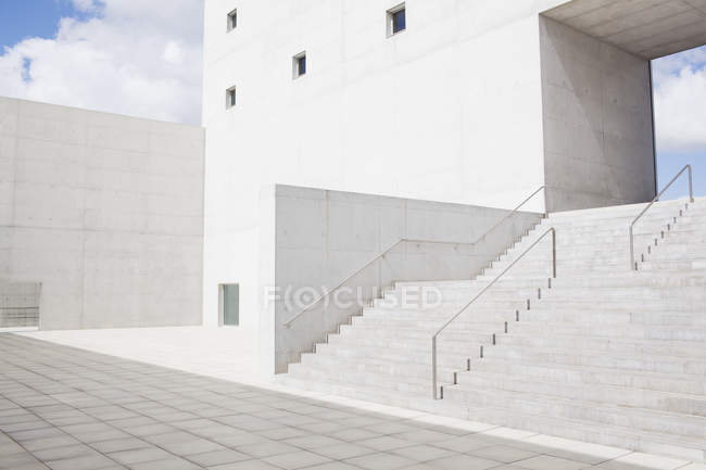 Facade of white modern building and stairs — Stock Photo
