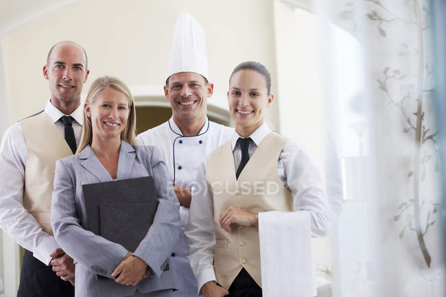 Staff smiling in restaurant indoors — Stock Photo