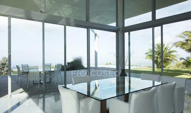 Glass table and chairs in modern office — Stock Photo