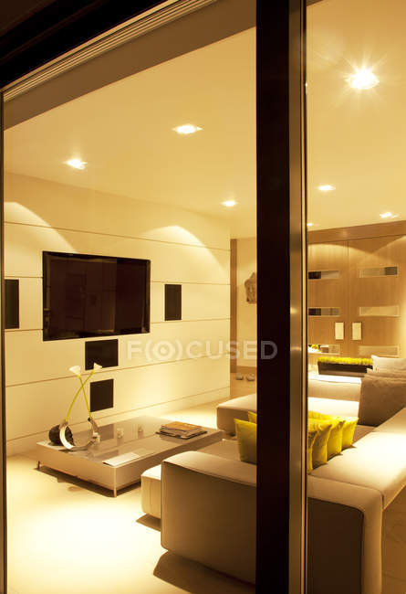 Illuminated living room of modern home — Stock Photo