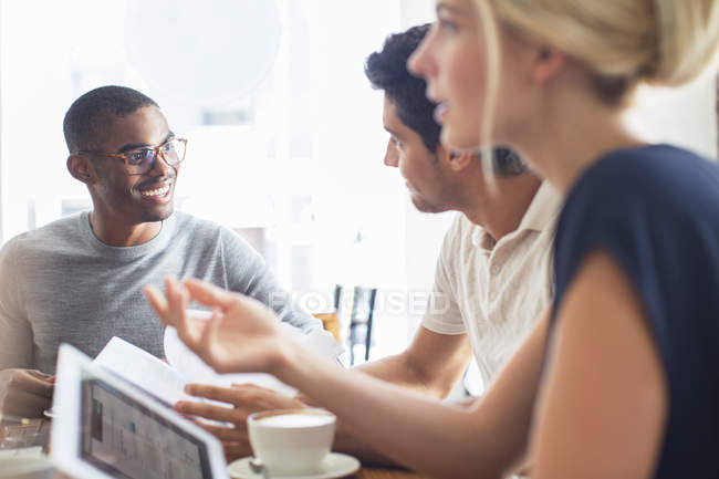 Business people talking at meeting in cafe — Stock Photo