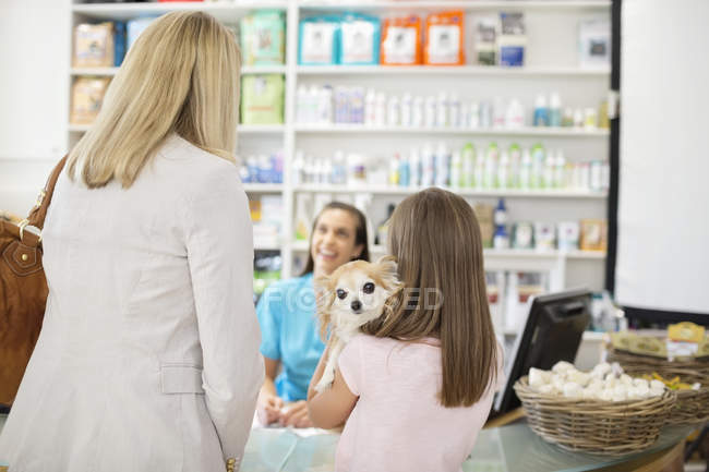 Owner bringing dog to veterinary surgery — Stock Photo