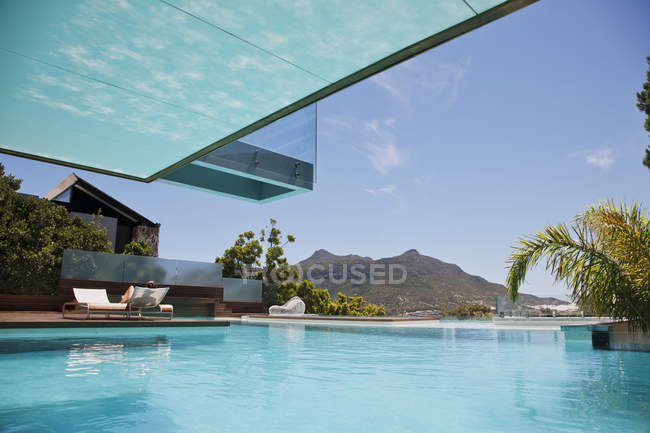 Luxury swimming pool with mountain view — Stock Photo