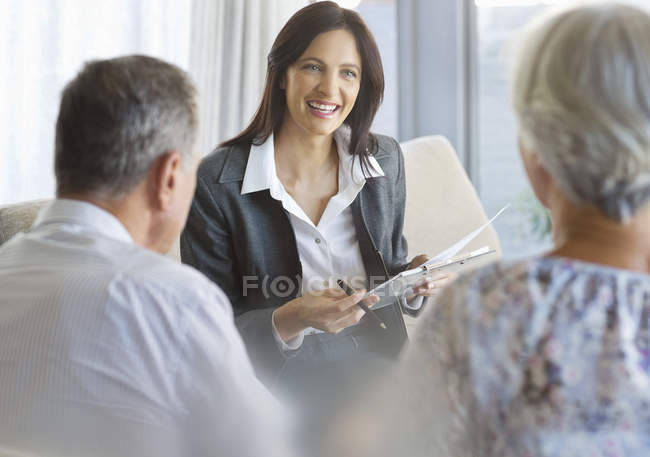Financial advisor talking to clients in office — Stock Photo