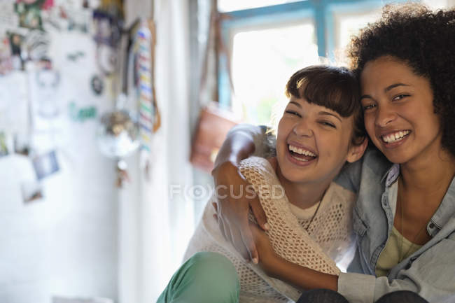 Young happy women hugging in bedroom — Stock Photo
