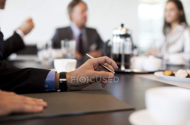 Close up of businessman hand in meeting at modern office — Stock Photo
