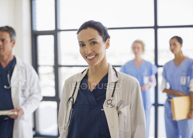 Portrait of smiling doctor in hospital — Stock Photo