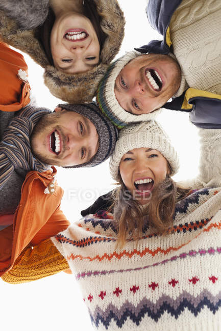 Low angle portrait of happy friends in huddle — Stock Photo