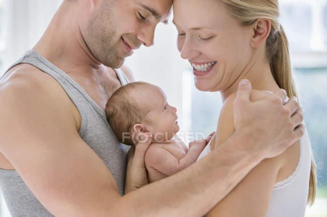 Parents cradling newborn baby — Stock Photo