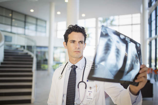 Doctor viewing chest x-rays in hospital — Stock Photo
