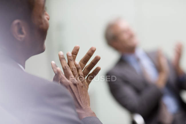 Businessmen clapping in meeting at modern office — Stock Photo
