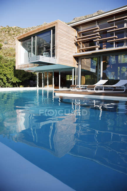Modern house interior and swimming pool — Stock Photo