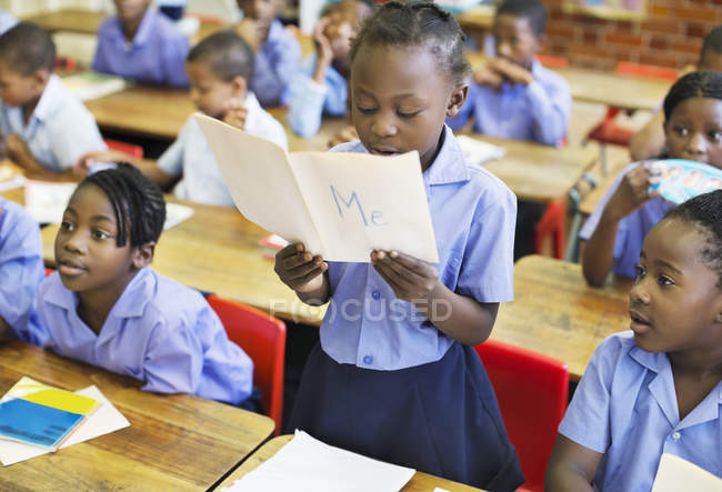 African american student reading aloud in class — Stock Photo