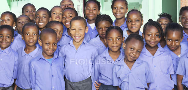 African american students smiling together in classroom — Stock Photo