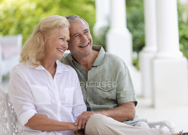 Older caucasian couple hugging on porch — Stock Photo