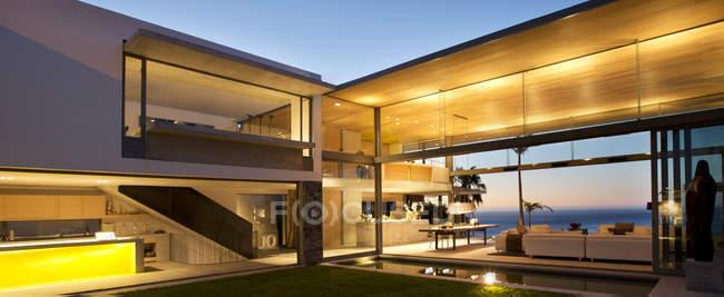 Illuminated patio of modern house — Stock Photo