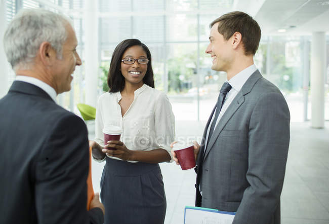 Business people talking in office building — Stock Photo
