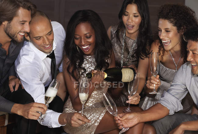 Young attractive Friends drinking champagne at party — Stock Photo