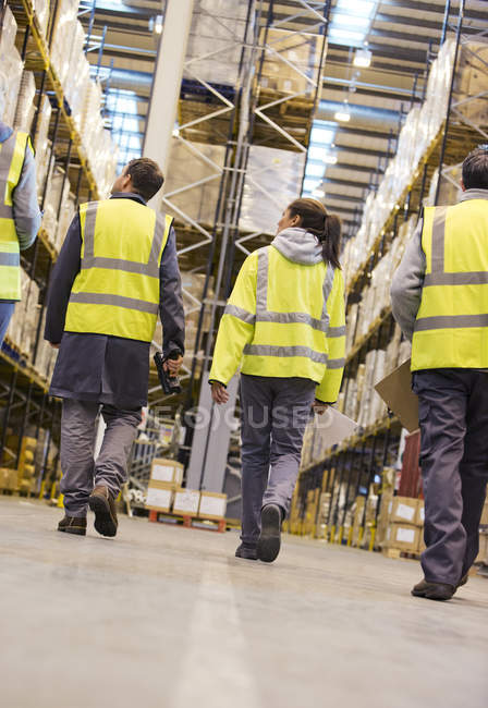 Workers walking in warehouse — Stock Photo