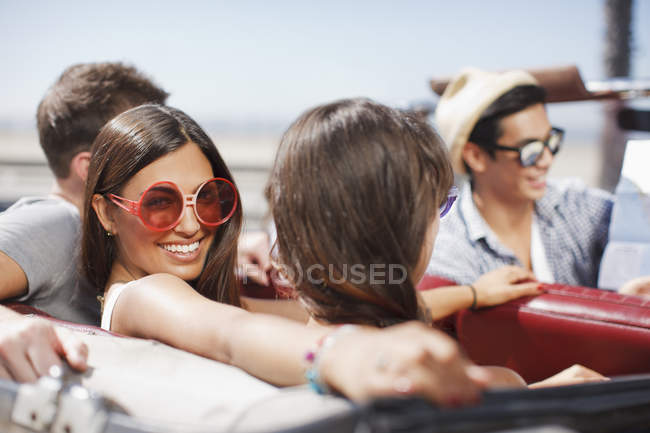 Friends driving in convertible — Stock Photo