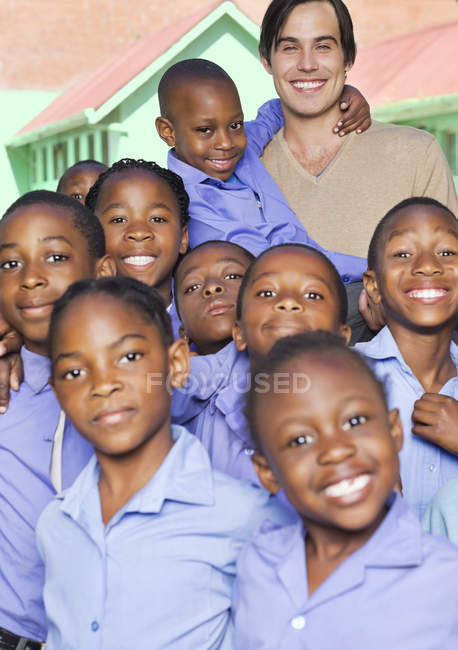 African american students and teachers smiling outdoors — Stock Photo
