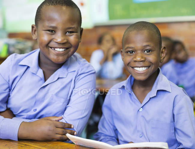 African american students smiling in class — Stock Photo