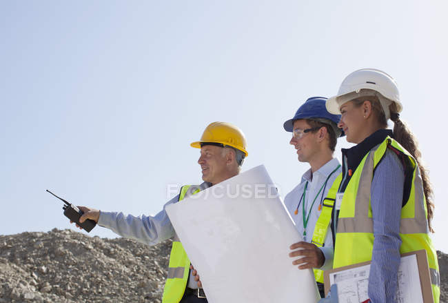 Business people talking in quarry — Stock Photo