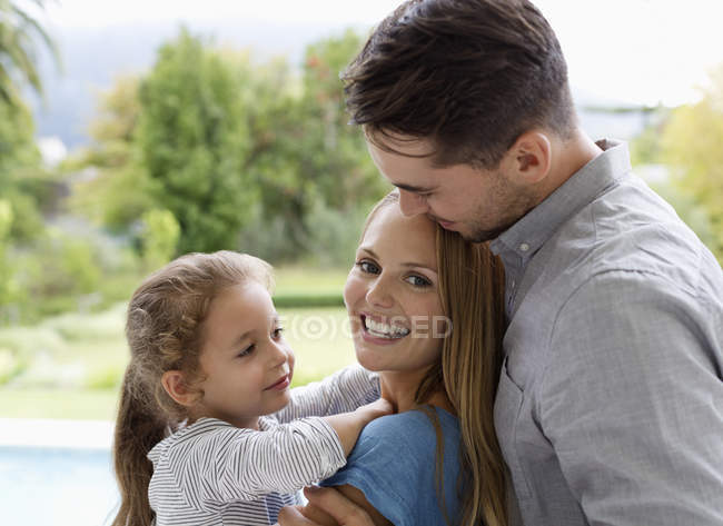 Happy family smiling together outdoors — Stock Photo