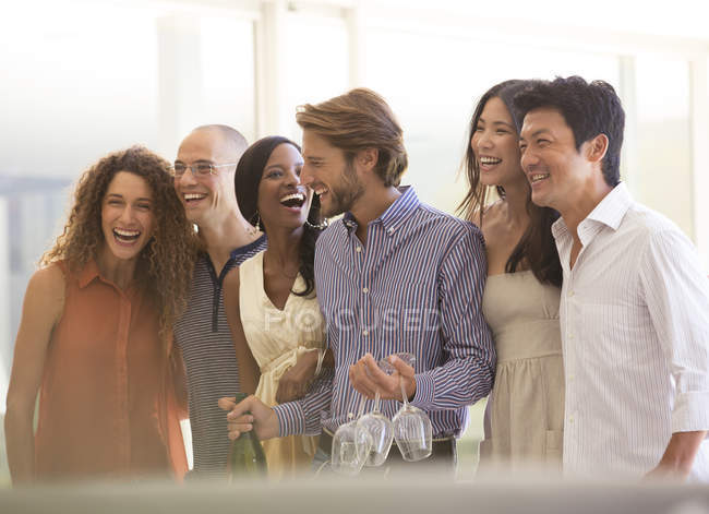 Young attractive Friends laughing together at party — Stock Photo